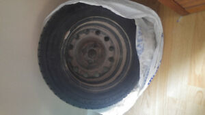 4 Used winter tires on rims. Size 175/70R14 34T