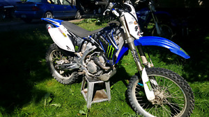 2009 Yamaha 250 f lots of upgrades and in very good condition .