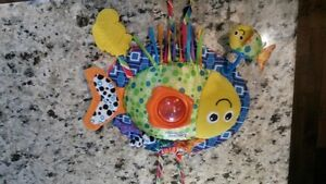 LAMAZE CRIB TOY ATTACHES SAFELY TO CRIB. BRIGHT COLOURS