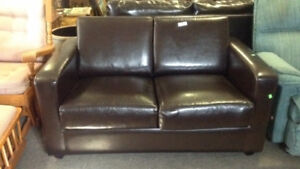 Brown leather love seat, chair, 3 cushion couch and ottoman