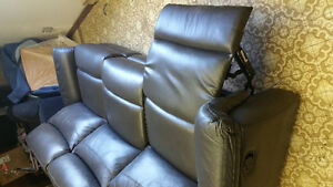 Leather couch new with double reclining