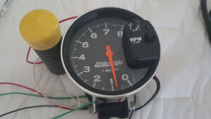"Auto Meter 5"" Monster Tach. With Shift Light. And mounting brack"