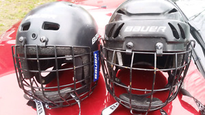 2 Bauer youth helmets for sale with face guards.