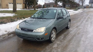 2005 Ford Focus ZX5 1 owner with safety e-test & car proof