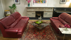 Modern italian leather sofa and loveseat in red. Non smoker 500