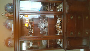 Wooden cabinet with glass display.