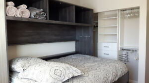 Furnished bedroom in two bedroom condo near Lougheed Town Centre