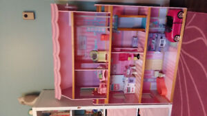 Barbie house with Barbies and accessories for sale