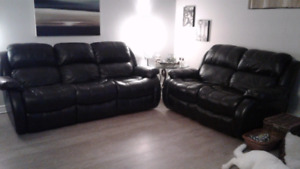 Reclinable black leather couches