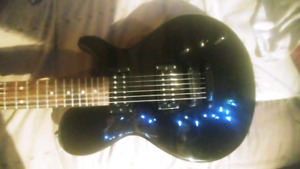 Dean guitar with case and Marshall amp