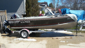 1989 Lund Tyee 5.3  trade for 24' cuddy