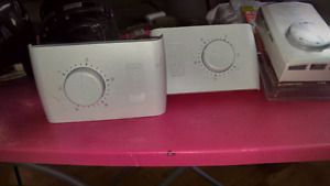2 Honeywell single pole thermostats...and 1 dimplex double pole