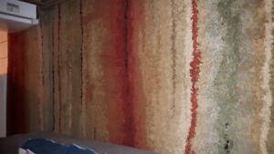 """1 - 9'10"""" x 6'6"""" carpet, multi-coloured."""