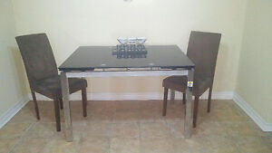 Black and Silver Glass dining table from Leons