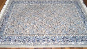 5 'x 7'.6 beige / blue area rug