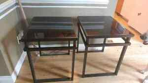 2 black glass side tables