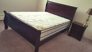 Queen size bed with mattress and night table