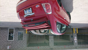 2013 Red Convertable Fiat 500C with red leather interior