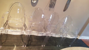 Clear lucite ghost chairs