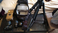 Nikon D3000 with case, tripod and extra lens