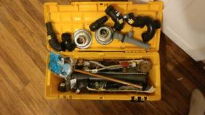 Toolbox full of plumbing supplies