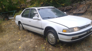 91 Honda Accord with summers and new studded  winters