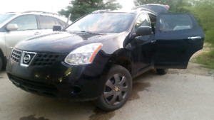 2010 black Nissan rogue awd with command start