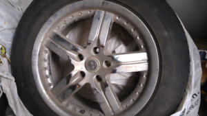 3 tires mounted on factory 2008 Dodge Charger rims
