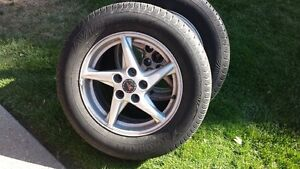 2  P225 60 16 Grand Prix wheels and tires