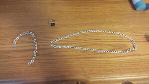 im selling a 925 sterling silver necklace and bracelet and pinky