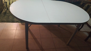 White sturdy table with leaf and 3 chairs