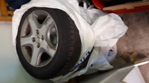 Set of 4 2005 Honda civic tires with rims and hubcaps $150.