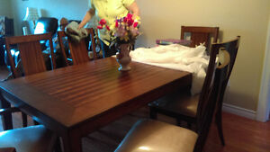 Just like new, dining room table set.