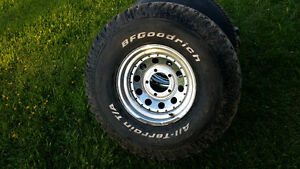 4  15 inch BFG All Terrains on chrome rims fit Ford or Jeep