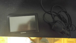 Garmin GPS set of 2 used but work well NEED GONE ASAP