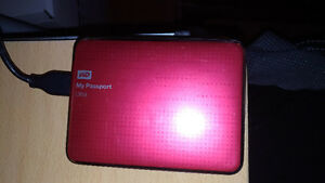 WD my passport ultra 2 TB. red colour