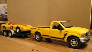 Diecast cars and a truck with trailer