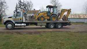 Flatbed heavy towing and equipment relocation