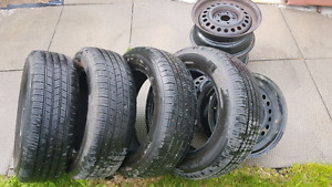 Michelin 195/65 R15 Tires  with rim. Over 80% tread remains