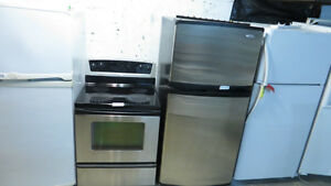 THE WISE SHOP HAS A ALMOST NEW STAINLESS FRIDGE  & STOVE