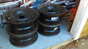 4- 6.5 X 15 STEEL RIMS AND NEVER USED FULL SIZE SPARE