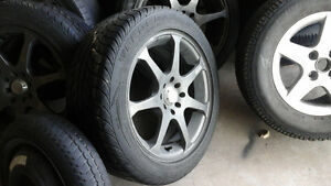 215 60 14  RIMS AND TIRES $200  ALMOST FREE !!!! MINT TIRES 90%