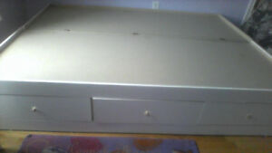 white glossy queen bed with lots of storage