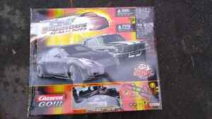 Fast and furious electric car racing track. 2 cars
