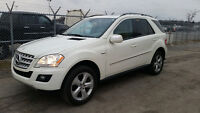 2009 Mercedes-Benz M-Class White on tan SUV, Crossover