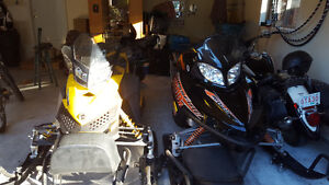 His and her sleds for sale or trade for side-by-side