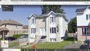 Grand logement 5 1/2 avec garage