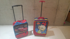 2 kids size pull suit cases