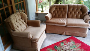 Beige loveseat and swivel chair