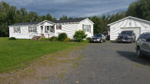 newer Maple Leaf mini on own land with garage